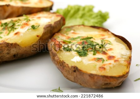 Baked potato with cheese and lettuce - stock photo