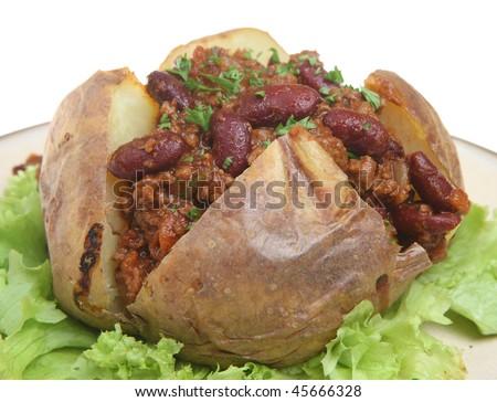 Baked potato with chili - stock photo