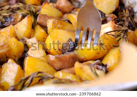 baked potato with mushrooms and rosemary - stock photo