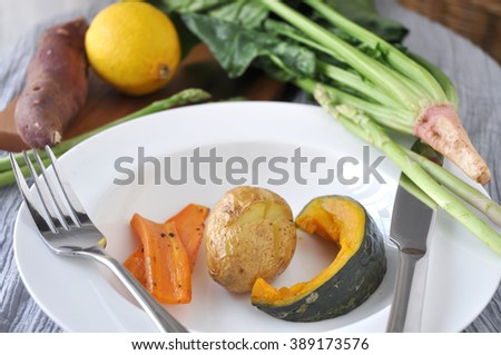 Baked Potato with pumpkin and carrot dish - stock photo