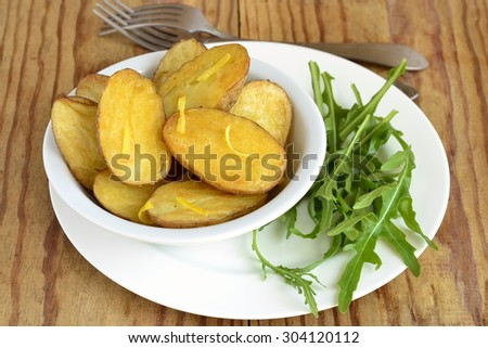 Baked potatoes with arugula and lemon zest