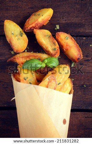 Baked potatoes with chive from above on the wooden table  - stock photo