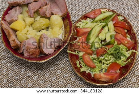 Baked potatoes with meat and vegetable salad