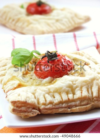 baked puff pastry with cheese, bacon and tomato