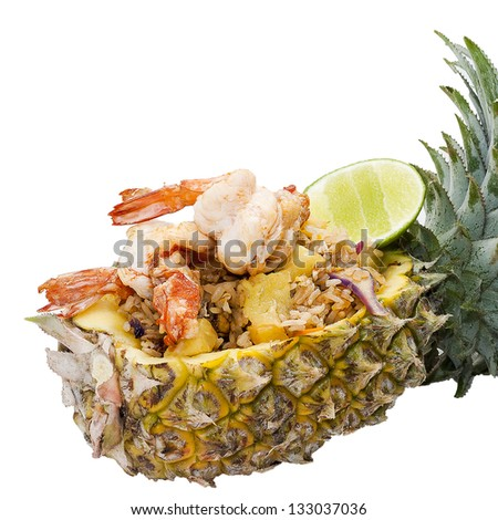 Baked rice with pineapple served in a pineapple