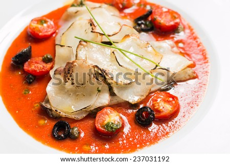 Baked salmon file with cherry tomatoes, olives and capers - stock photo