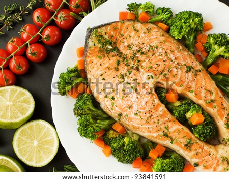 Baked salmon steak with stir-fry veggies. Viewed from above. - stock photo