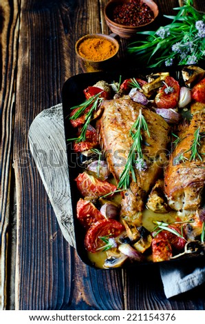 Baked sea bass with vegetables and herbs - stock photo
