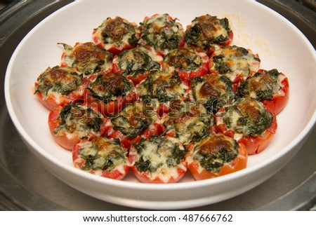 baked spinach in tomatoes with mozzarella cheese