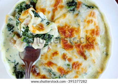 Baked Spinach with Cheese. - stock photo