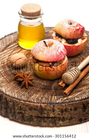 Baked stuffed apples with honey, nuts and dried fruits - stock photo