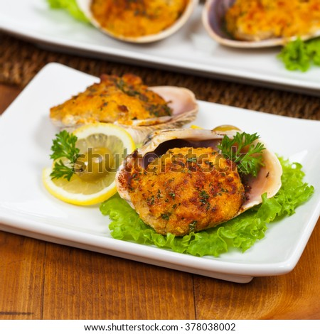 Baked Stuffed Clams. Selective focus. - stock photo