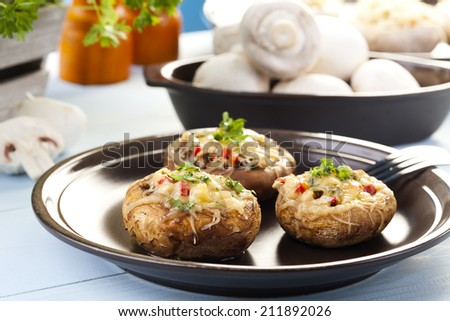 Baked stuffed mushrooms with cheese - stock photo