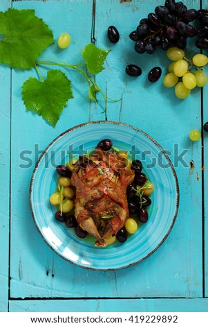 Baked stuffed quail with grape sauce. - stock photo