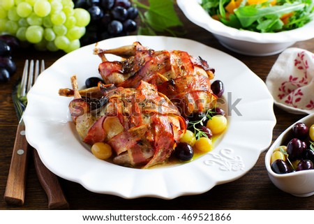 Baked stuffed quail with grape sauce.