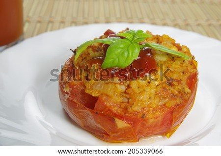 baked stuffed tomato with meat and rice  - stock photo