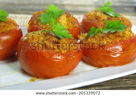 baked stuffed tomatoes with meat and rice  - stock photo