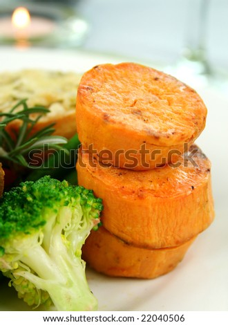 Baked sweet potato stack with broccoli and rosemary. - stock photo