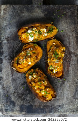 Baked sweet potato with feta cheese and chives - stock photo