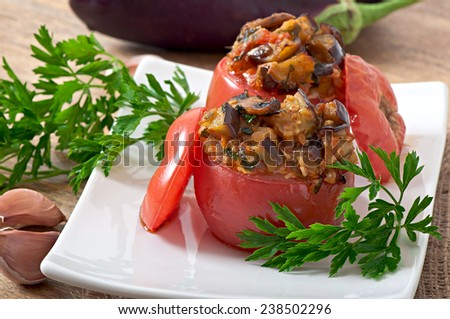 Baked tomatoes stuffed with eggplant and mushrooms - stock photo