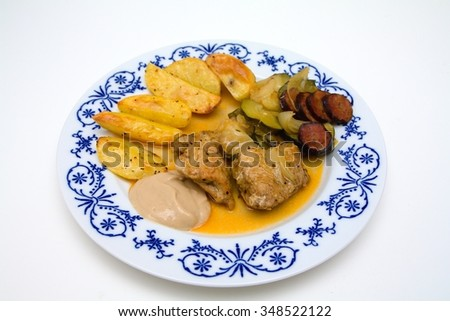 Baked turkey with sausage, potatoes and vegetables - stock photo