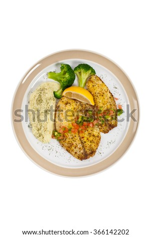 Baked white fish fillet and Mashed Potatoes on white background. Selective focus. - stock photo