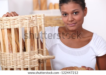 Baker posing with her bread - stock photo