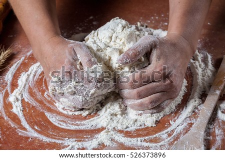 Baker prepared dough for baking delicious on  kitchen table