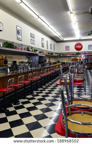 BAKERSFIELD, CA - APR 22, 2014: The floor is cleaned and chairs ready to be put down to await customers at this classic lunch counter still in service in a former F. W. Woolworth building.
