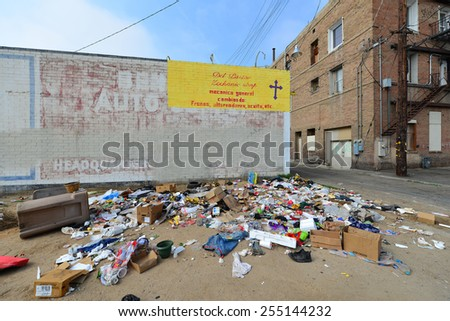 BAKERSFIELD, CA - FEBRUARY 20, 2015: The homeless, with nowhere to dispose of trash or conduct normal activities, add to the urban blight of the inner city. - stock photo