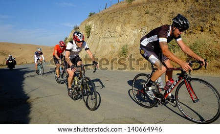 BAKERSFIELD, CA - JUN 1: The men's 50 mile race turns into an uphill struggle during the District Road Race Championships on June 1, 2013, at Bakersfield, California. - stock photo