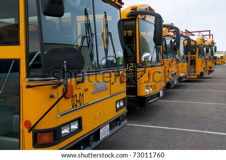 """BAKERSFIELD, CA - MAR 12: The 28th Annual School Bus """"Roadeo"""" tests driver skills on March 12, 2011, in Bakersfield, California. Buses line up for the start of competition. - stock photo"""