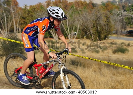 BAKERSFIELD, CA - NOV 7: Riding down a steep hill in the Junior Boys' Race of the  Fifth Annual Hart Park Cyclocross on November 7, 2009, at Bakersfield, California.