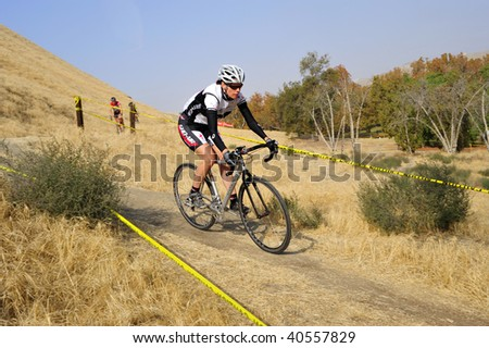 BAKERSFIELD, CA - NOV 7: Women's downhill racing action during the Fifth Annual Hart Park Cyclocross on November 7, 2009, at Bakersfield, California.