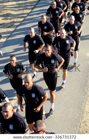 BAKERSFIELD, CA - NOVEMBER 7, 2015: Police academy cadets start together and run as a group behind their banner for the 33rd Annual Bakersfield Police Department Memorial Run.