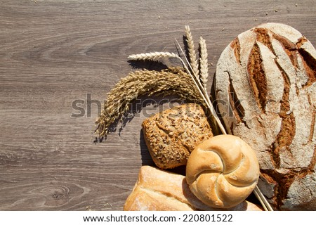 bakery bread and sheaf over wood background - stock photo