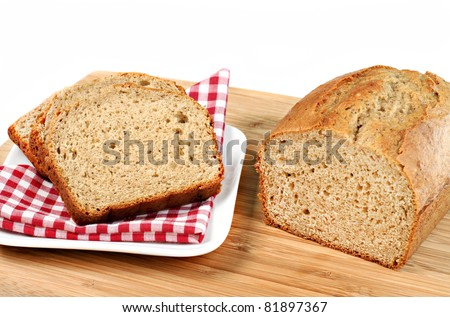 Bakery fresh banana bread, sliced and whole.  White background with copy space. - stock photo