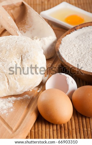 Bakery ingredient. Flour, raw eggs and dough for making bread