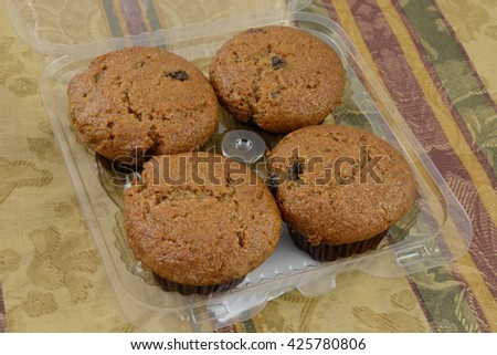 Bakery package of four raisin bran muffins - stock photo