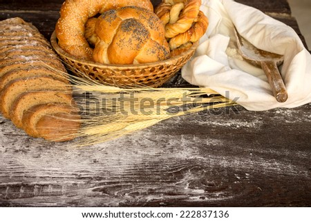 Bakery products in wicker basket on a wooden table