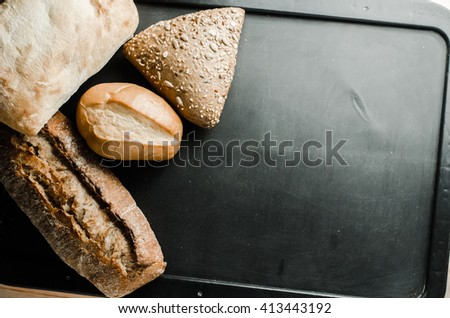 Bakery products on old wooden table - stock photo