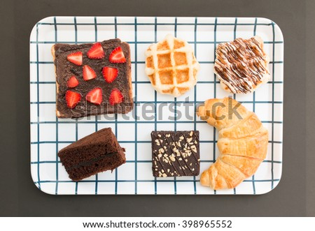 Bakery set of croissant, brownie,chocolate cake, waffle and chocolate topping strawberry.