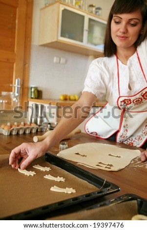 baking christmas cake, focus on woman's hand - stock photo