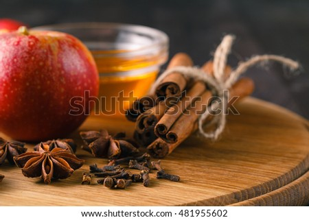 Baking concept background. Baking pastry and cookies: apples, spices, honney on wood
