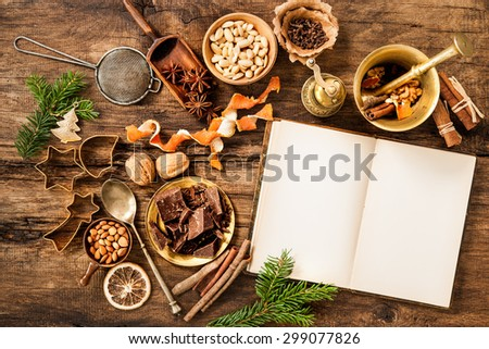 Baking concept background with cookbook, spices and utensils for Christmas cookies - stock photo