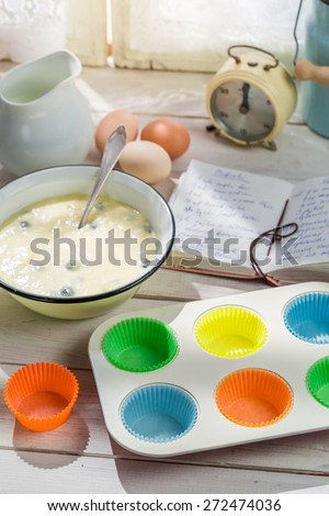 Baking delicious muffins with blueberries - stock photo