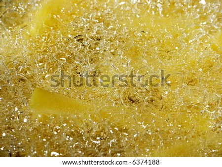 baking french fries - chips in oil, close up photo - stock photo