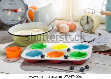 Baking fresh cupcakes with blueberries - stock photo