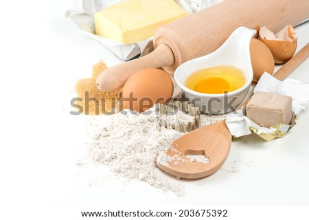 baking ingredients eggs, flour, yeast, sugar, butter. food background - stock photo