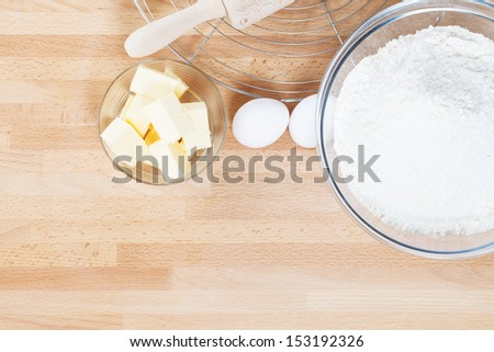 baking ingredients from top on wooden background